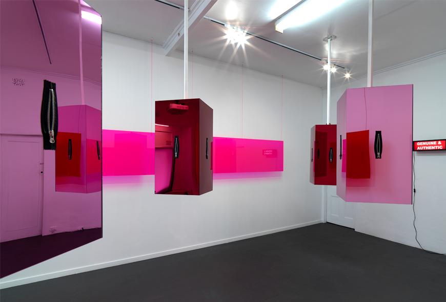 Derek Sargent,  Genuine and Authentic , 2018, mirror acrylic, fluro acrylic, zips, light box. Installation view, FELTspace, Adelaide. Photo Grant Hancock.