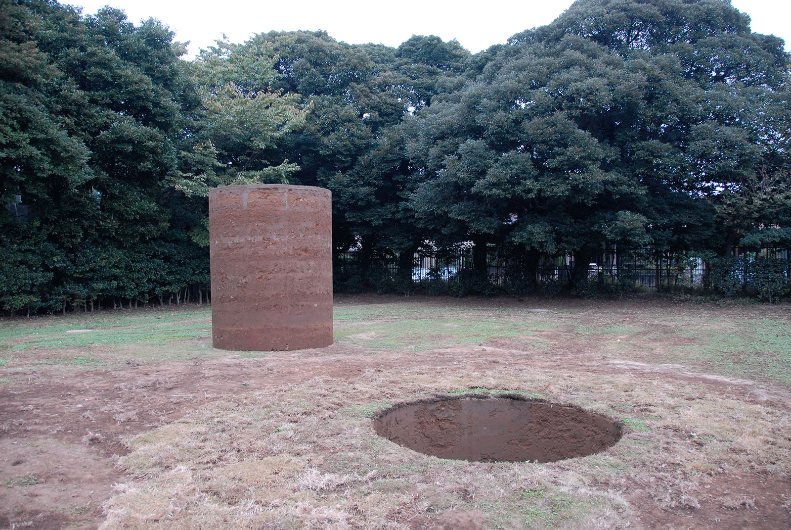 Nobuo Sekine,  Phase—Mother Earth , 1968 / 2008, Earth, cement, Cylinder: 220 x 270 (diameter) cm, Hole: 220 x 270 (diameter) cm, Installation view,  Tama Line Art Project,  Den-en Chōfu Seseragi Park, Tokyo, November 1 - 9, 2008. Photo: Ashley Rawlings.