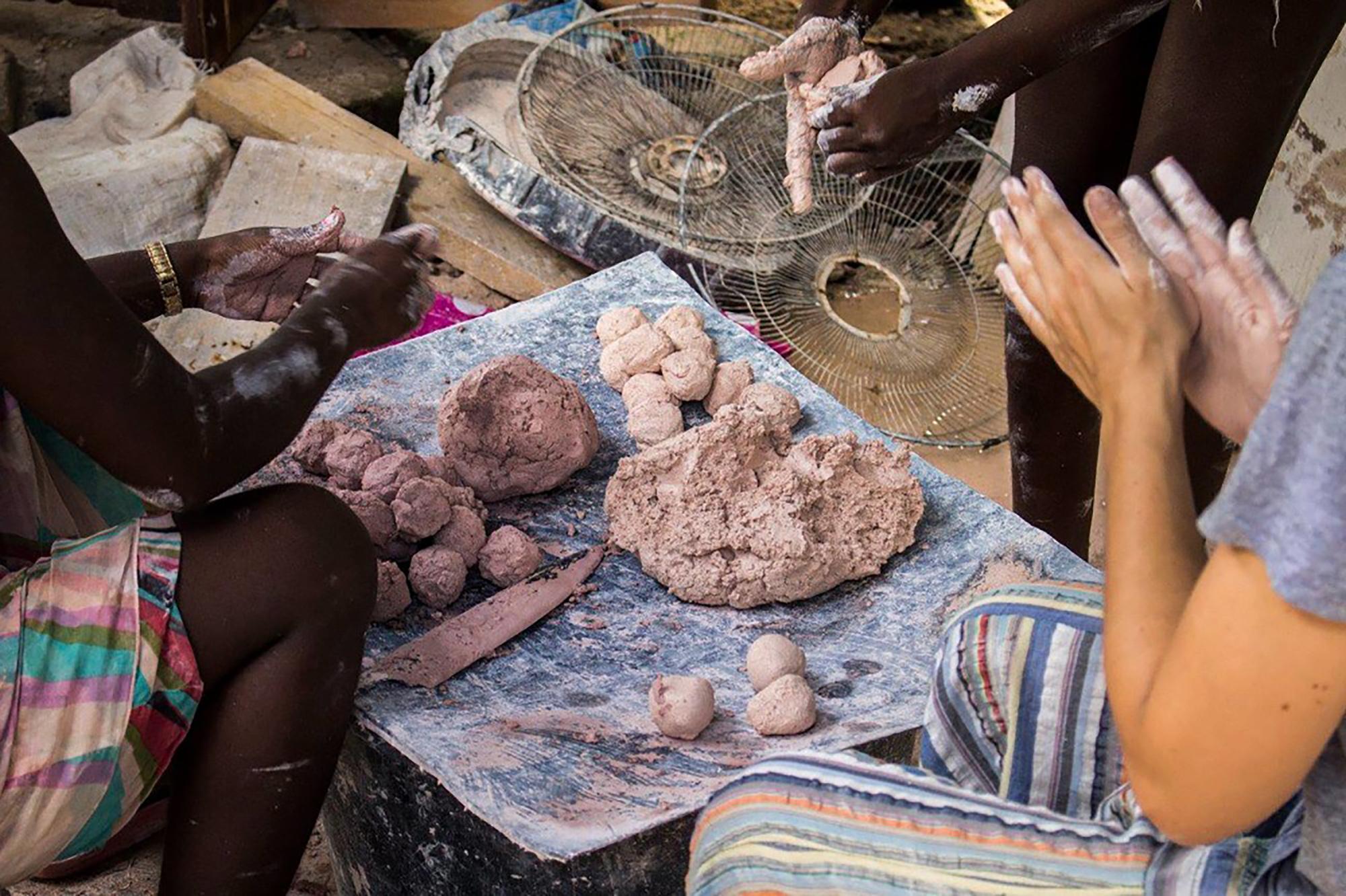 Masha Ru. Making balls of pimba in Paramaribo, Suriname. 2017. Image by Ielyj Ivgi. Photo courtesy the artist.