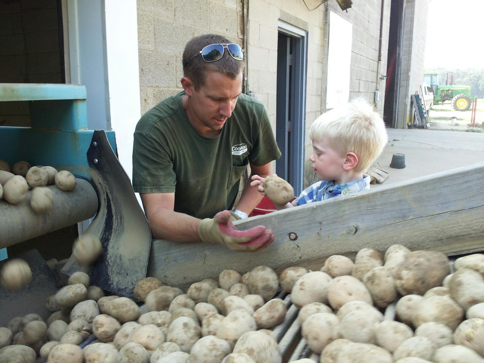 John Jr teaching son Lee about potatoes