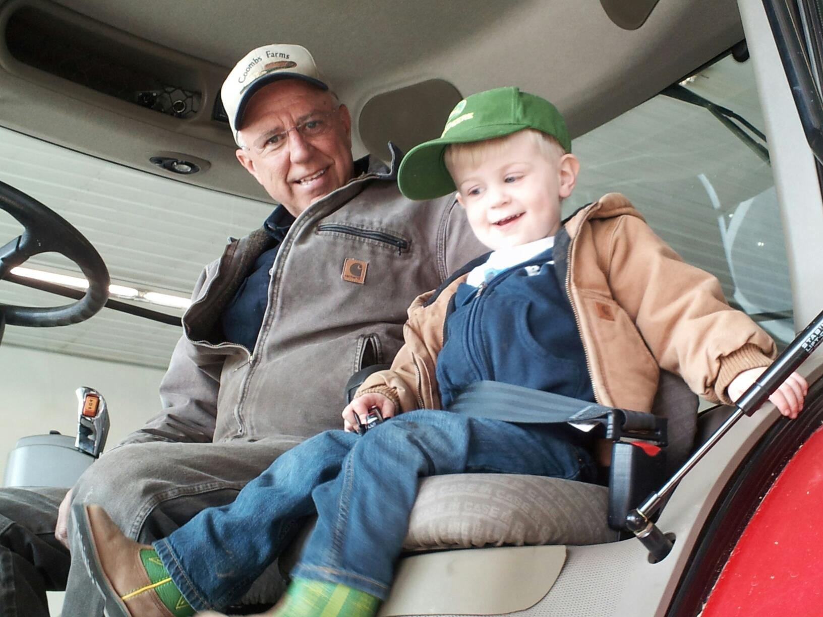 Lee teaching Poppop how to drive tractor