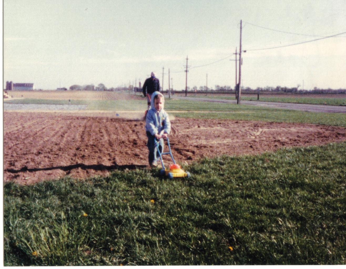 John and John Jr preparing their yard for grass seed in 1986