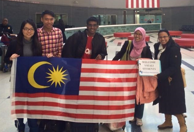 Meliani, pictured far right, welcoming  SUSI/YSEALI  students arriving in Philadelphia this past January.