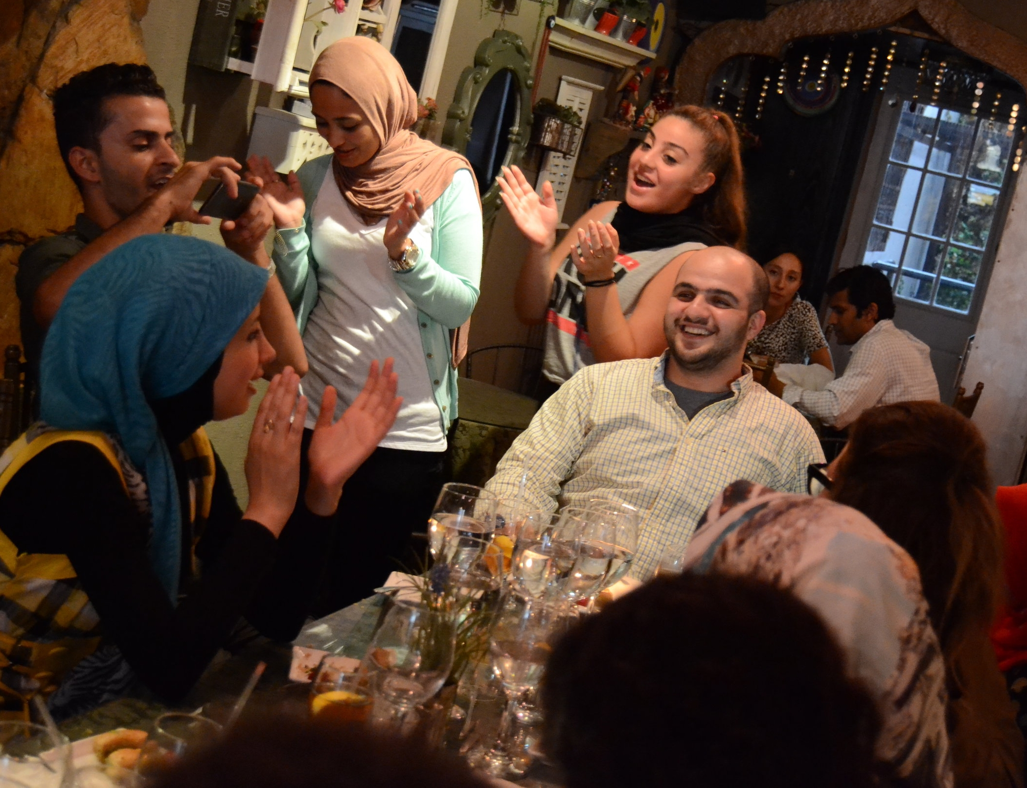 SUSI students celebrating Abdalla's birthday in New York City during last summer's Institute.