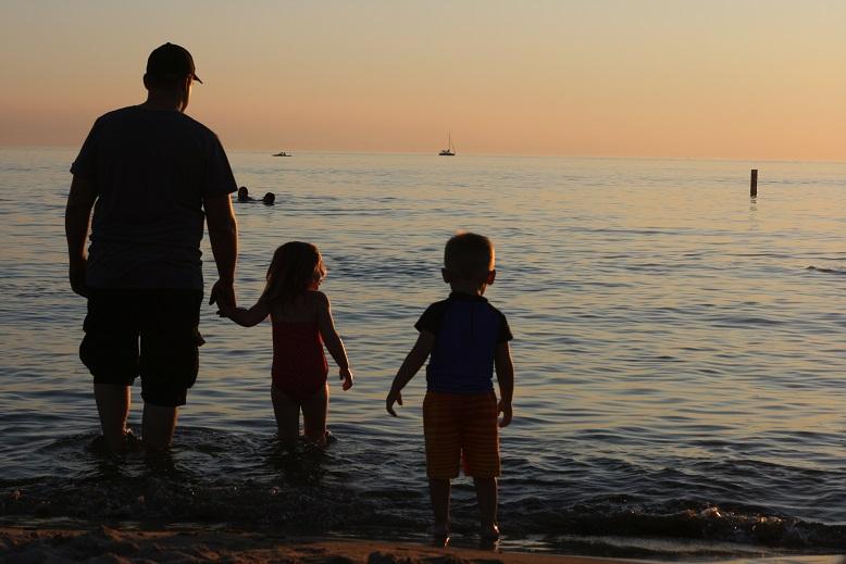 Isaac, Isaac Jr., and Whitney enjoying the sunset