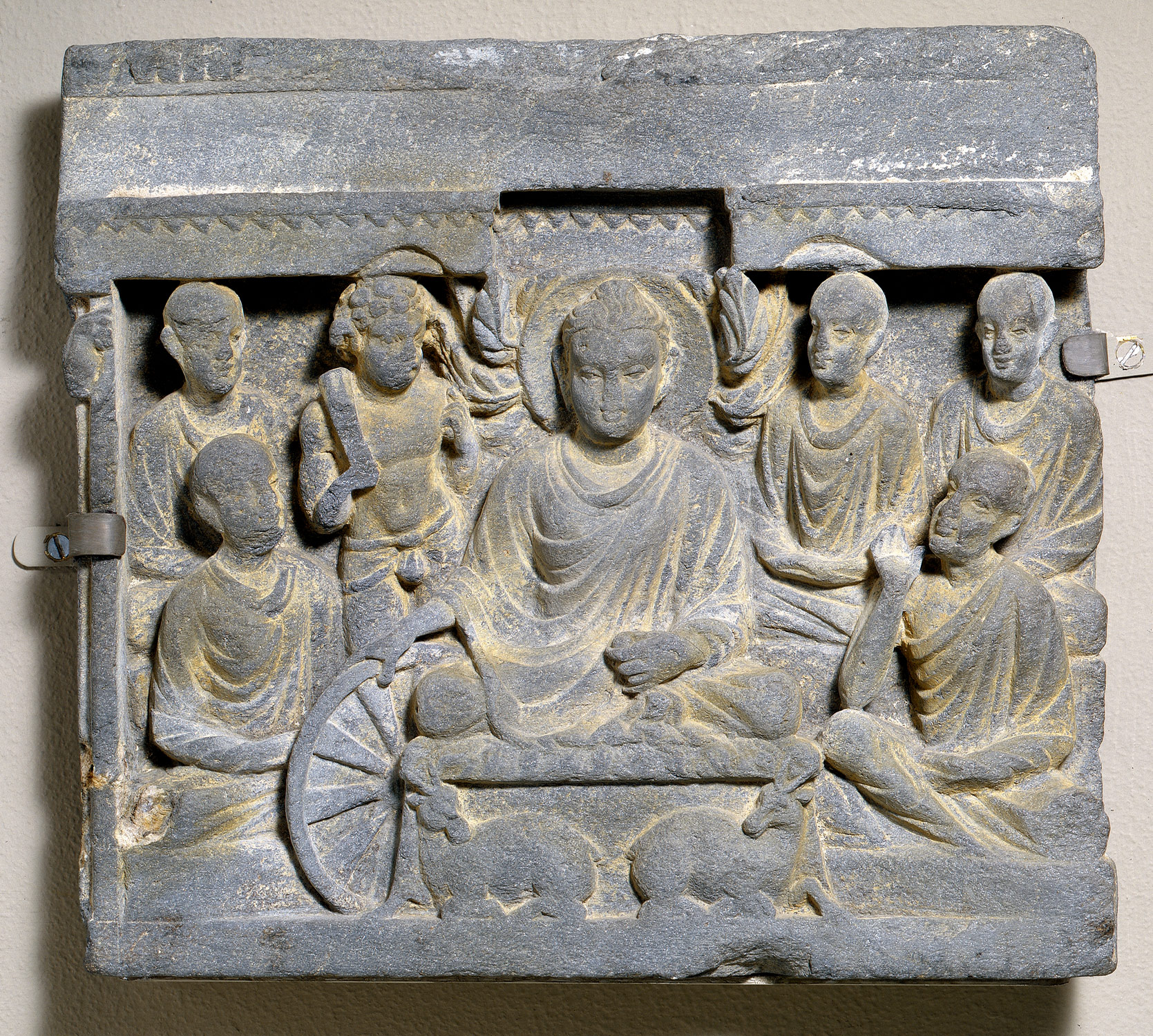 Buddha's First Sermon at Sarnath. 2nd century CE. Gandhara.  The Met .