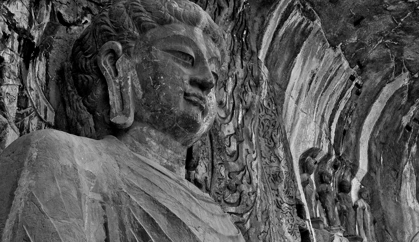 Buddha at the Longmen Grottoes. 493-534 CE. Northern Wei Dynasty. Luoyang, China.