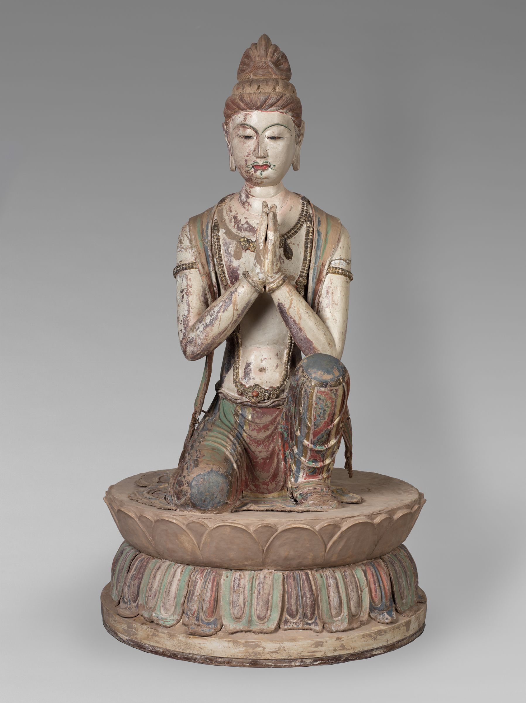 Kneeling Attendant Bodhisattva. From Mogao Cave 328. Late 7th century. Dunhuang. Image courtesy of the  Harvard Art Museums .