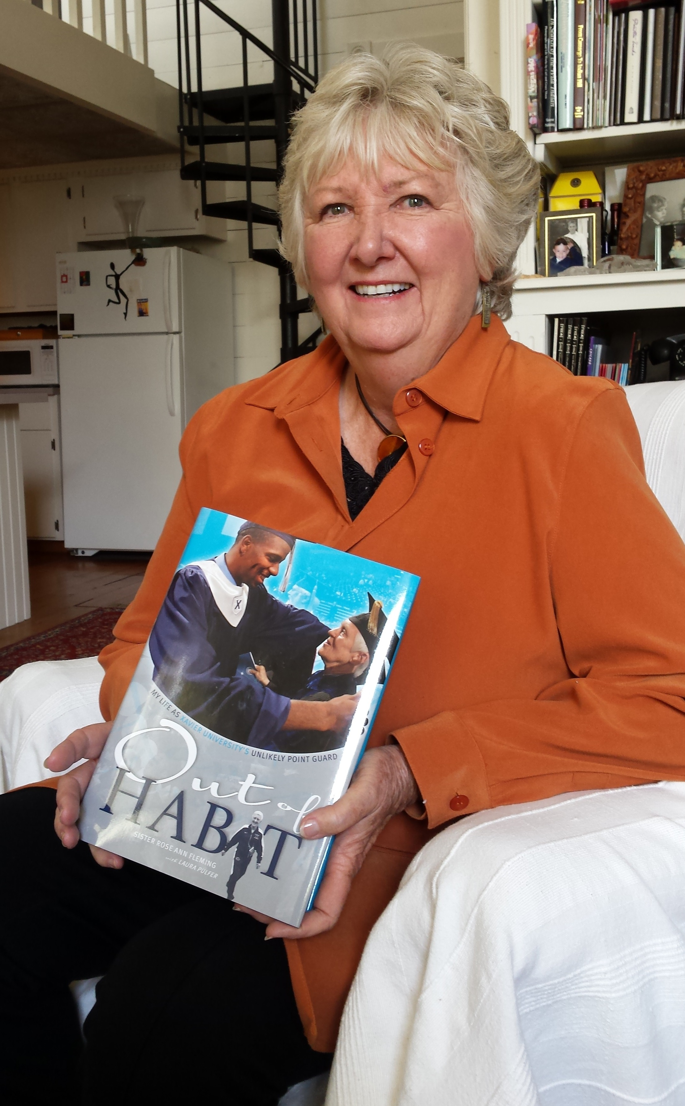 Laura Pulfer with Out of Habit, a book published for Xavier University to celebrate its beloved nun, Sister Rose Ann Fleming