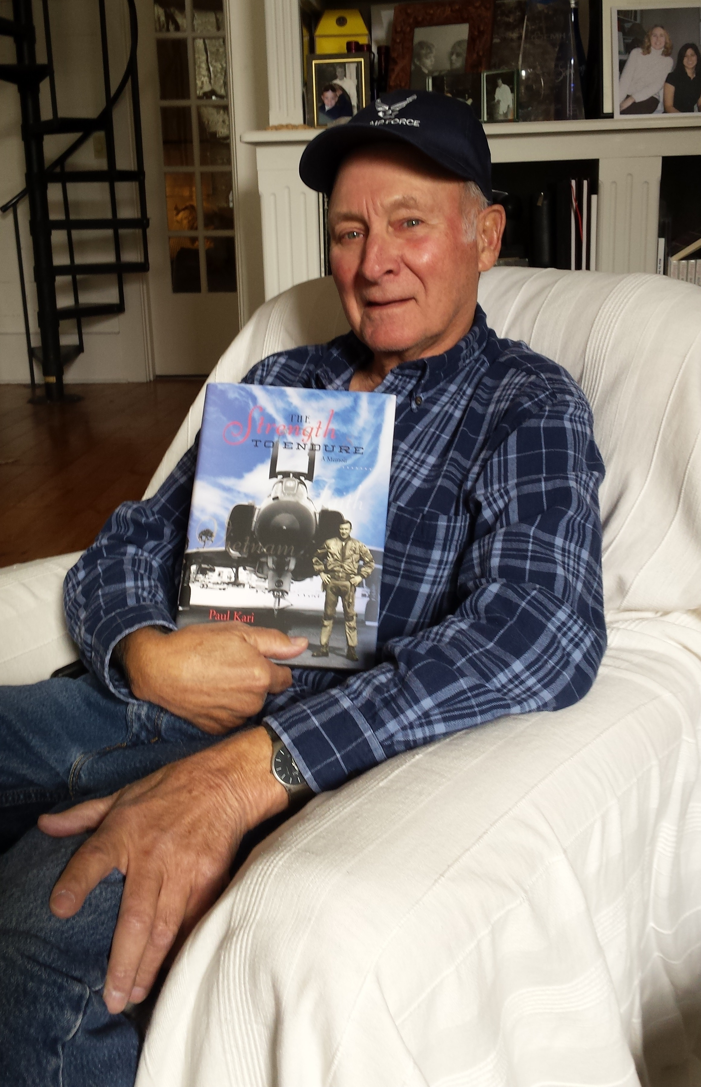 Paul Kari with his memoir, The Strength to Endure, a custom book published by Orange Frazer Press