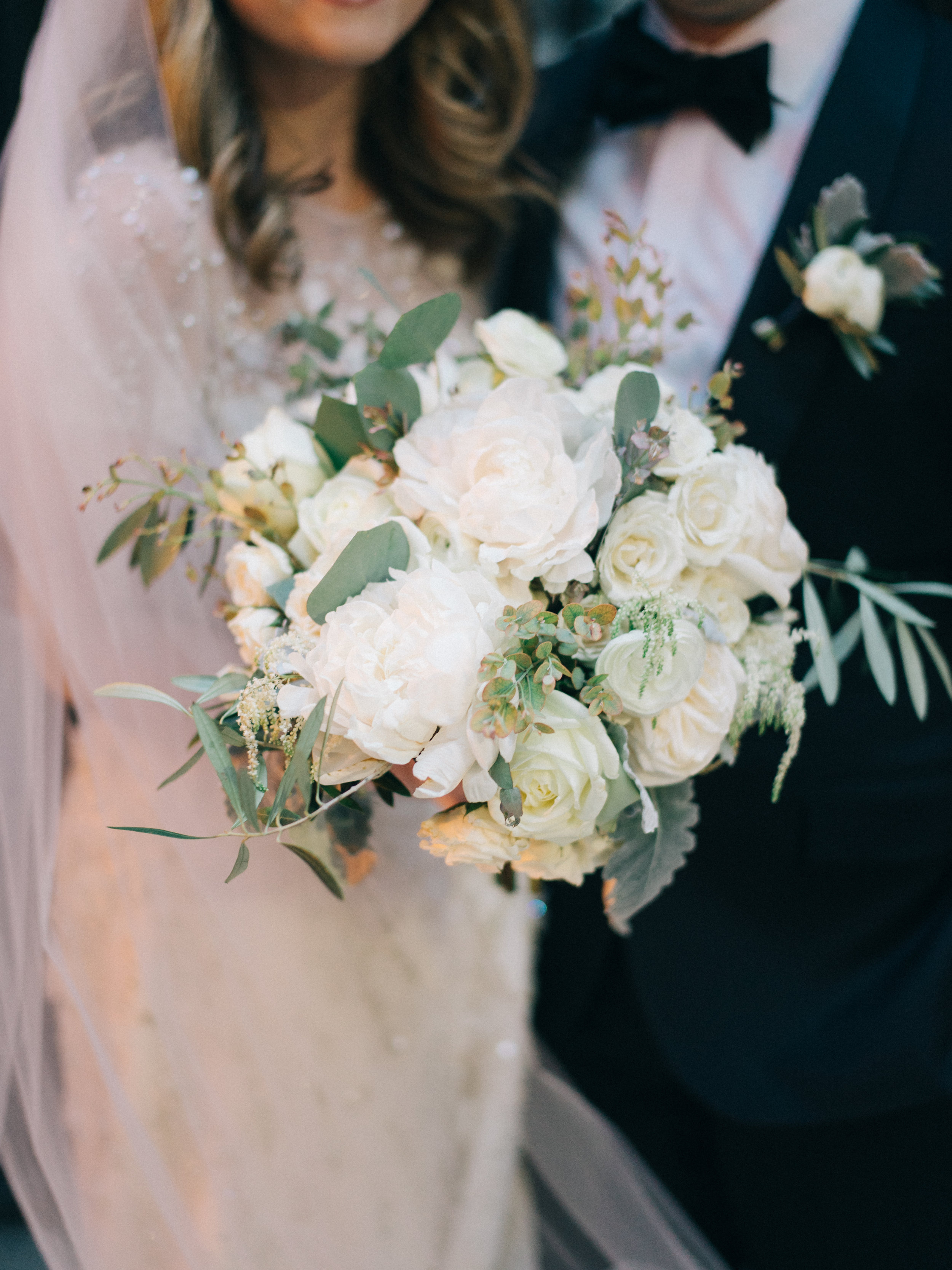 Flowers by Fleur Inc, Planning by Jayne Weddings, Photo by Sean Cook Weddings.  Lush, winter wedding bouquet with peonies