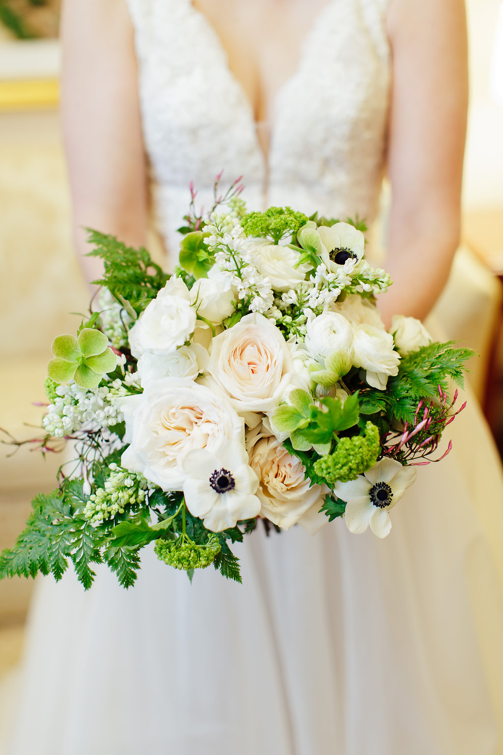 Green and Ivory bridal bouquet designed by Fleur Inc at the Union League Club in Chicago.  Photographed by Sarah Postma Photography.