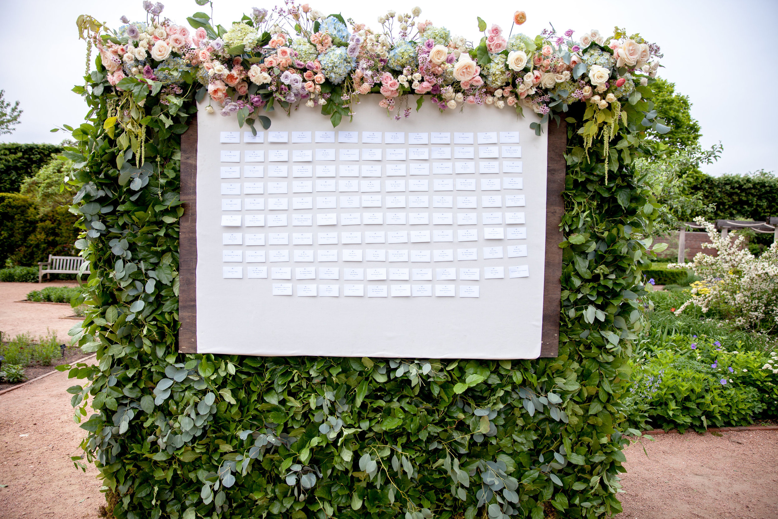 Escort flower wall by Fleur Inc at the Chicago Botanical Gardens.  Photo by Annie Steele, planning by BCR Events.