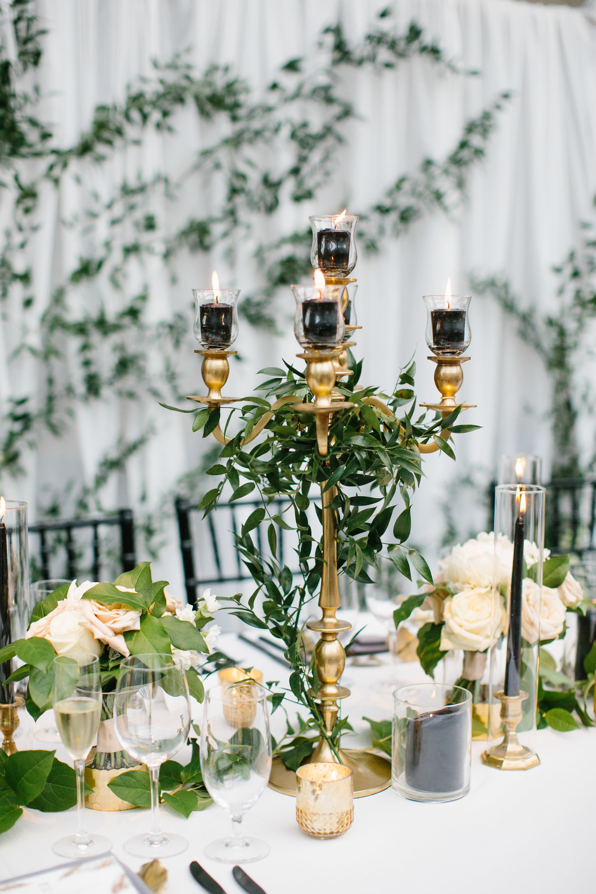 Wedding flowers by Fleur Inc at Chicago Illuminating Company.  Planning by LK Events, Images by Katie Kett Photography. Candelabra Centerpiece.