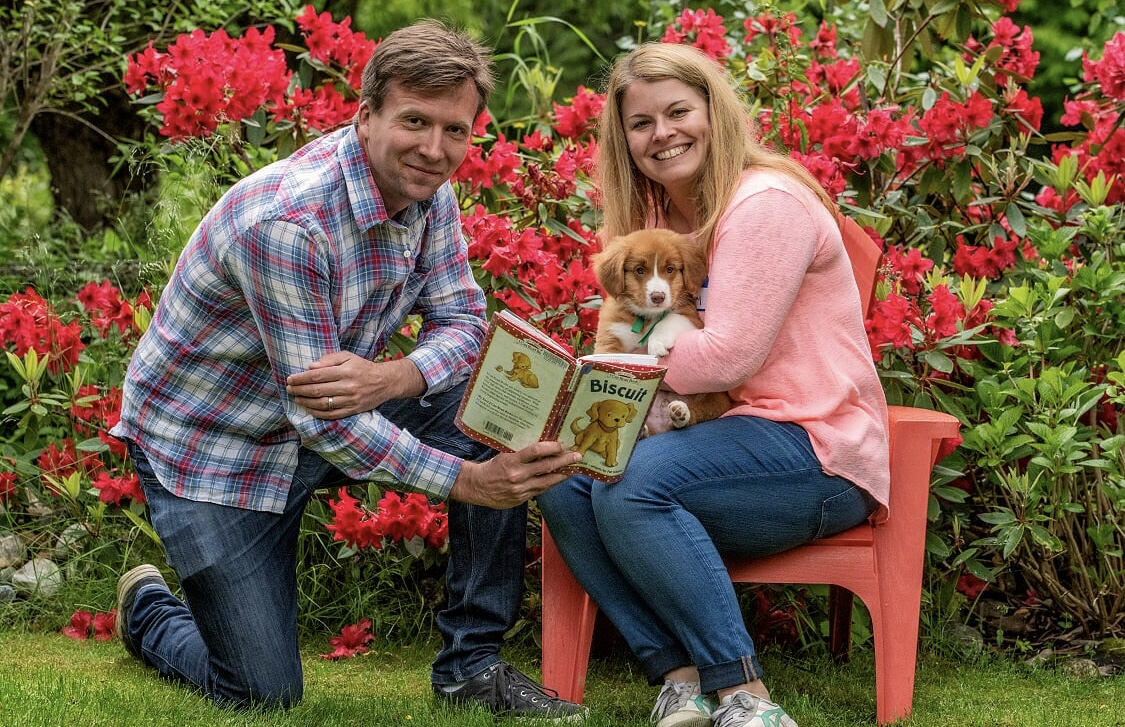 Mike and Lindsay reading to their puppy from the book he was named for. Pic: BC Farm and Family Photography
