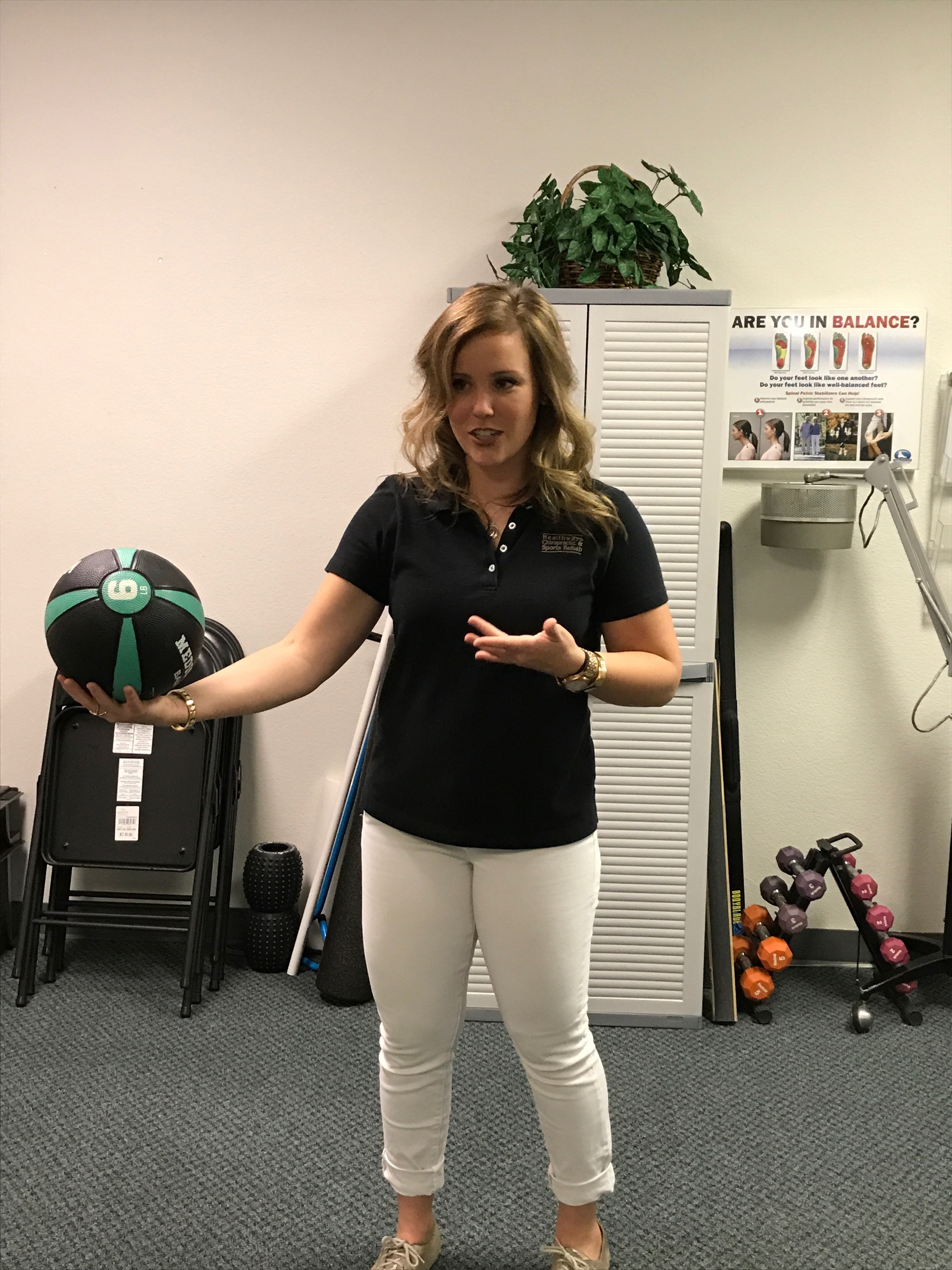 Posture Class:  Mom was right when she told you to stand up straight! Dr. Andrea using a medicine ball to demonstrate the importance of spinal biomechanics that are affected by poor posture.