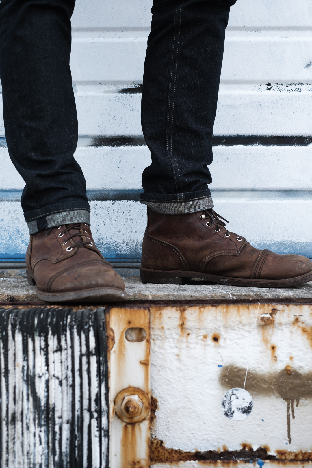 Male stands in modeling his Redwing Iron Ranger boots.