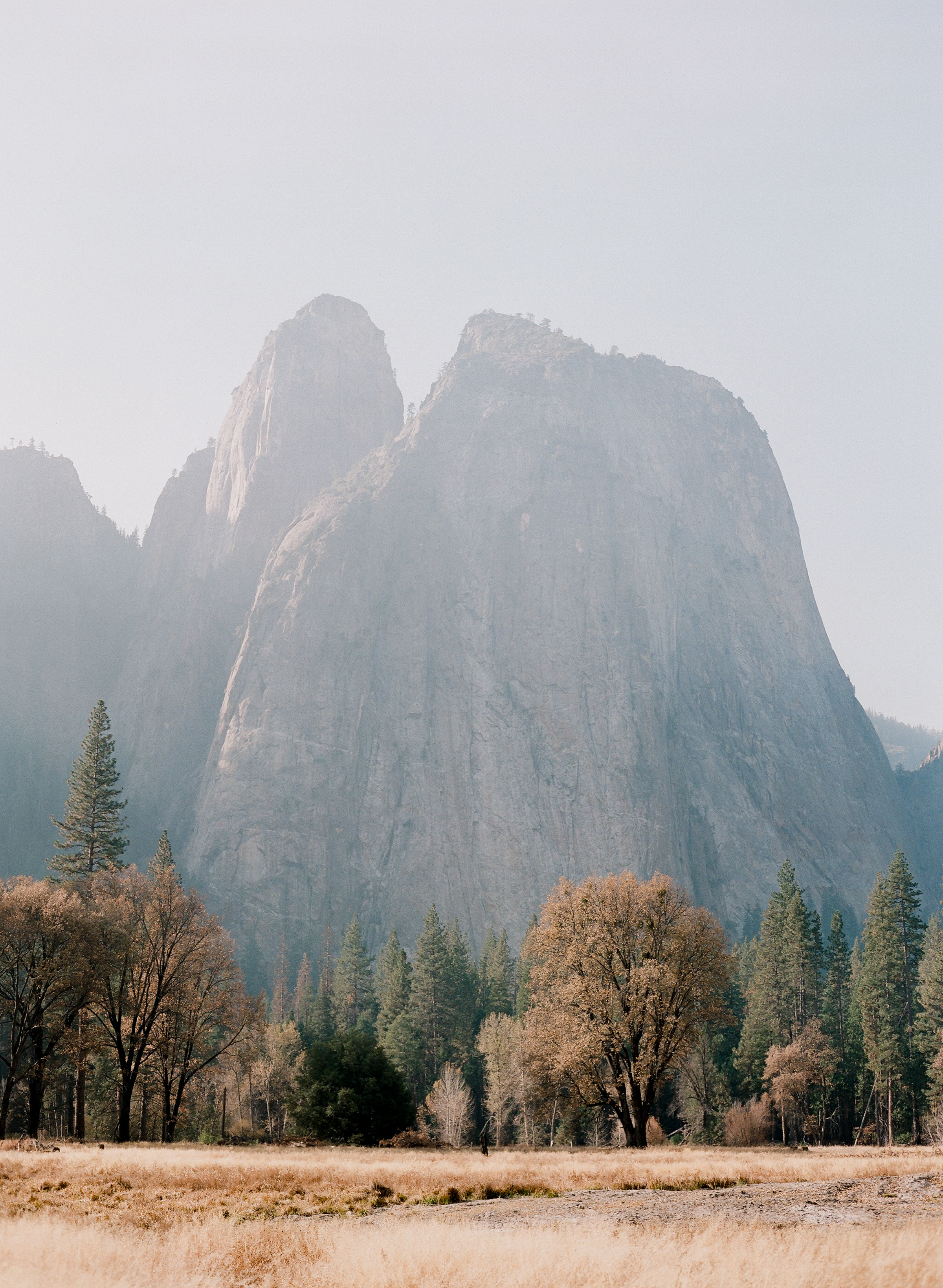 Cathedral Rock From El Capitan Meadow, Smoke