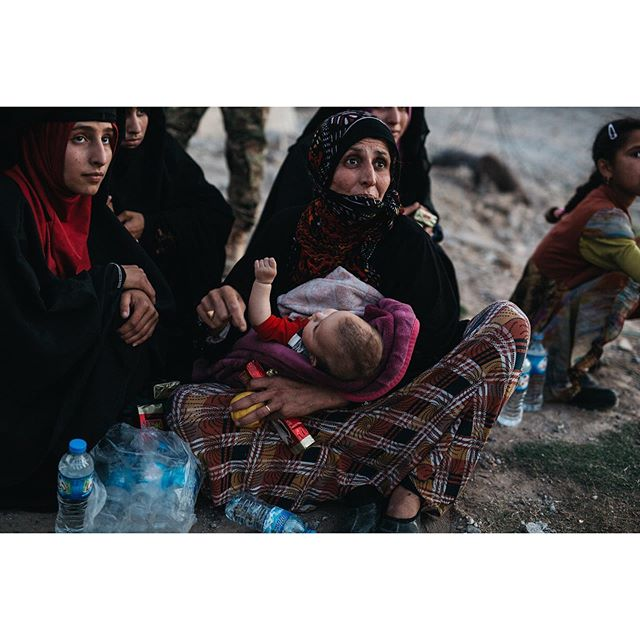 Reaching a safe point after leaving everything she knew behind, an Iraqi woman holds her child as she expresses the horror she's witnessed Iraq, West Mosul 2017