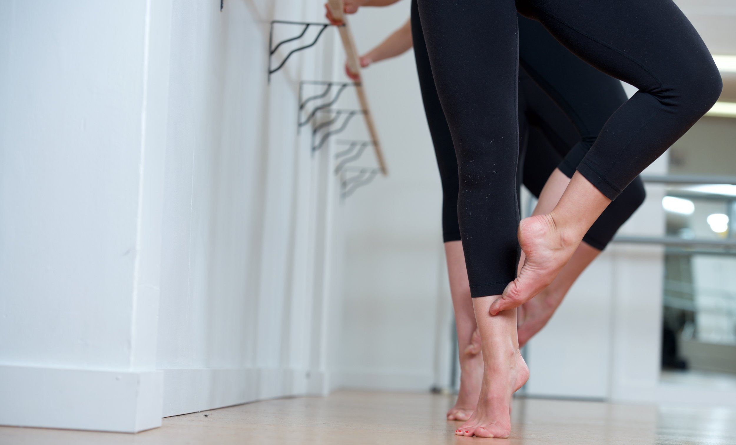 At barre - feet to knees.jpg
