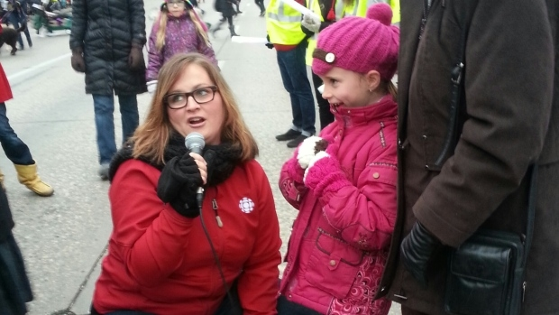 Marcy Markusa, host of the weekday morning radio show on CBC Radio One, is seen here touching base with onlookers at the 2013 Santa Claus Parade. (CBC)