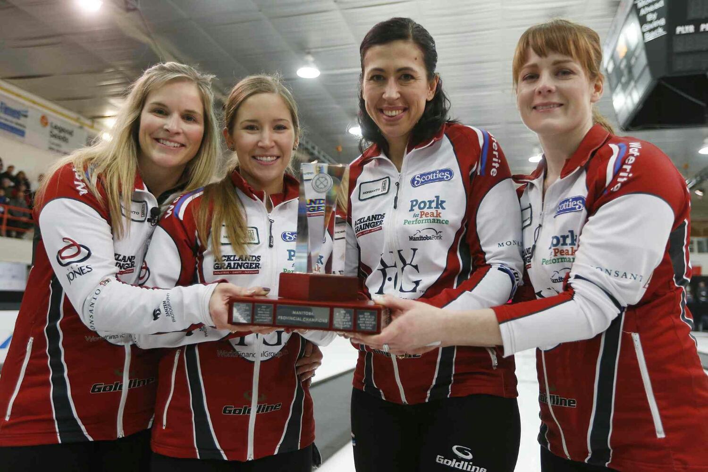 JOHN WOODS / WINNIPEG FREE PRESS  Jennifer Jones, Kaitlyn Laews, Jill Officer and Dawn McEwen (from left) celebrate winning the Manitoba title, beating Kerri Einarson Sunday.