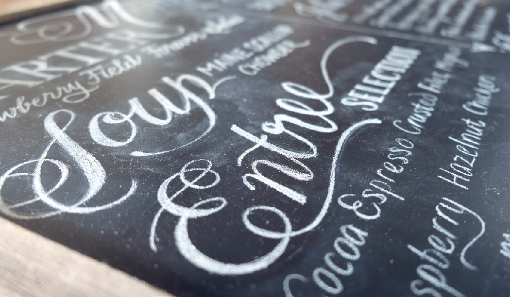 Wedding cocktail hour chalkboard lettering by www.chavelli.com