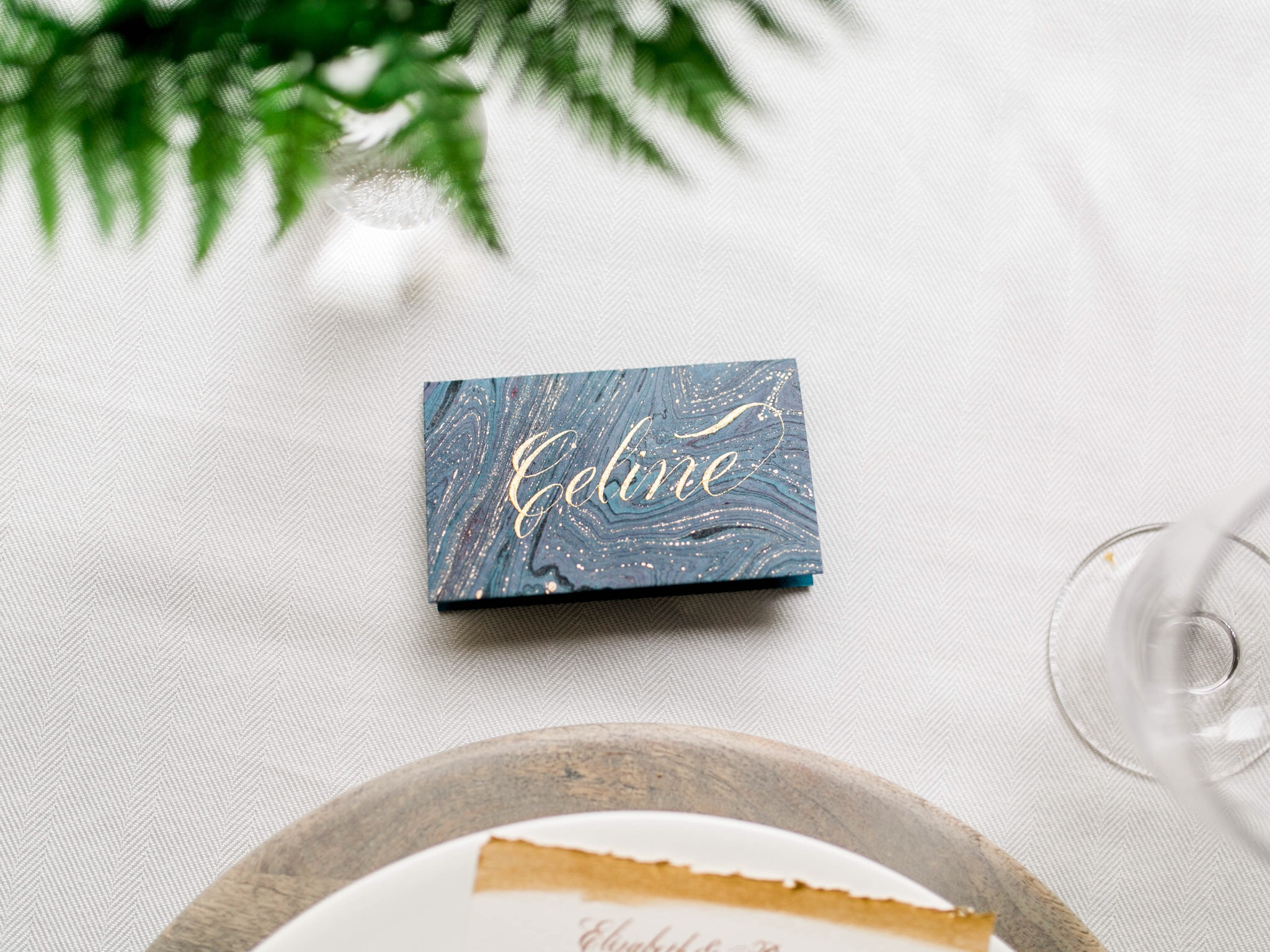 Gold calligraphy on marbled paper place cards // Calligraphy by www.chavelli.com