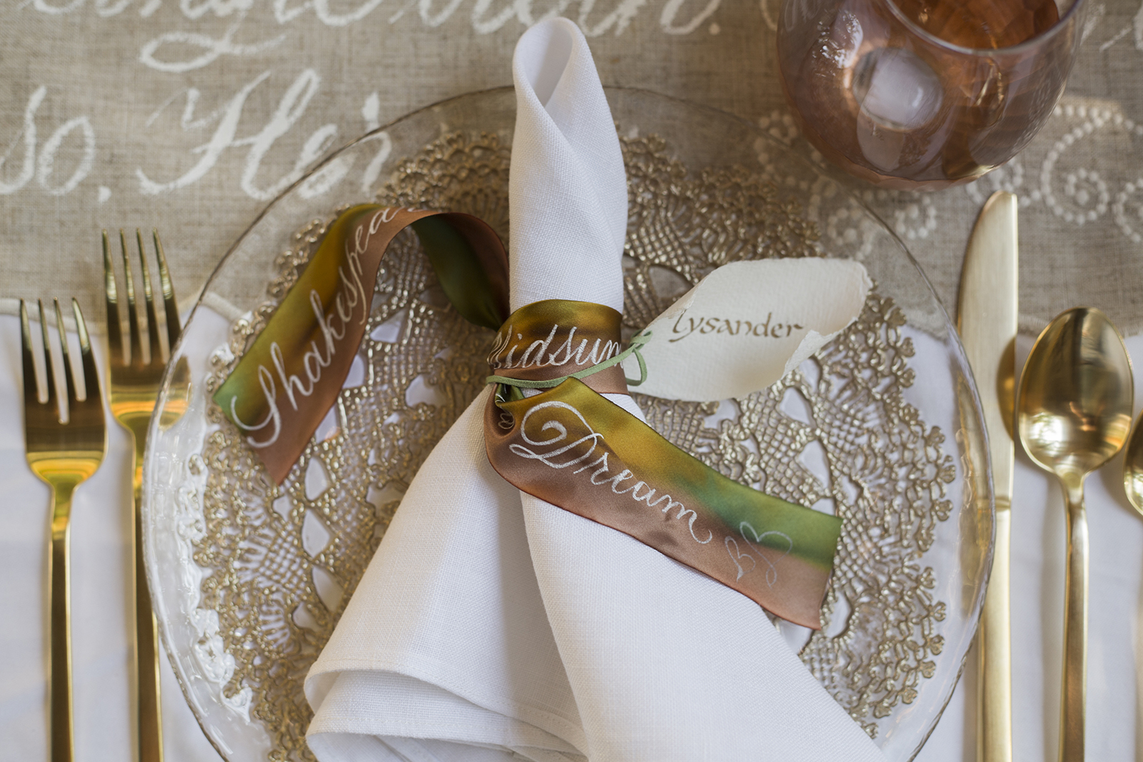 Midsummer Night's Dream inspired wedding shoot // historic Carolingian calligraphy in rose gold on hand-made paper place card scrolls // hand-painted silk ribbons with calligraphy // design and calligraphy by Chavelli www.chavelli.com // photography by Rebecca Jeanson www.rjimagery.com