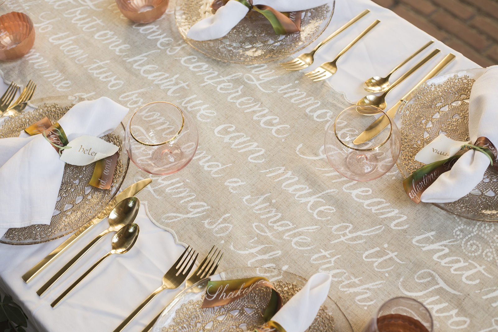 Midsummer Night's Dream inspired wedding shoot // scalloped table runner hand-painted with calligraphy // historic Carolingian calligraphy in rose gold on hand-made paper place card scrolls // hand-painted silk ribbons with calligraphy // paperie and calligraphy by Chavelli www.chavelli.com // photography by Rebecca Jeanson www.rjimagery.com