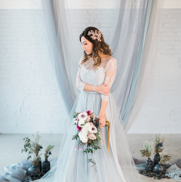 Custom backdrop in chiffon and tulle in ocean hues hung from driftwood |  The BAYITH