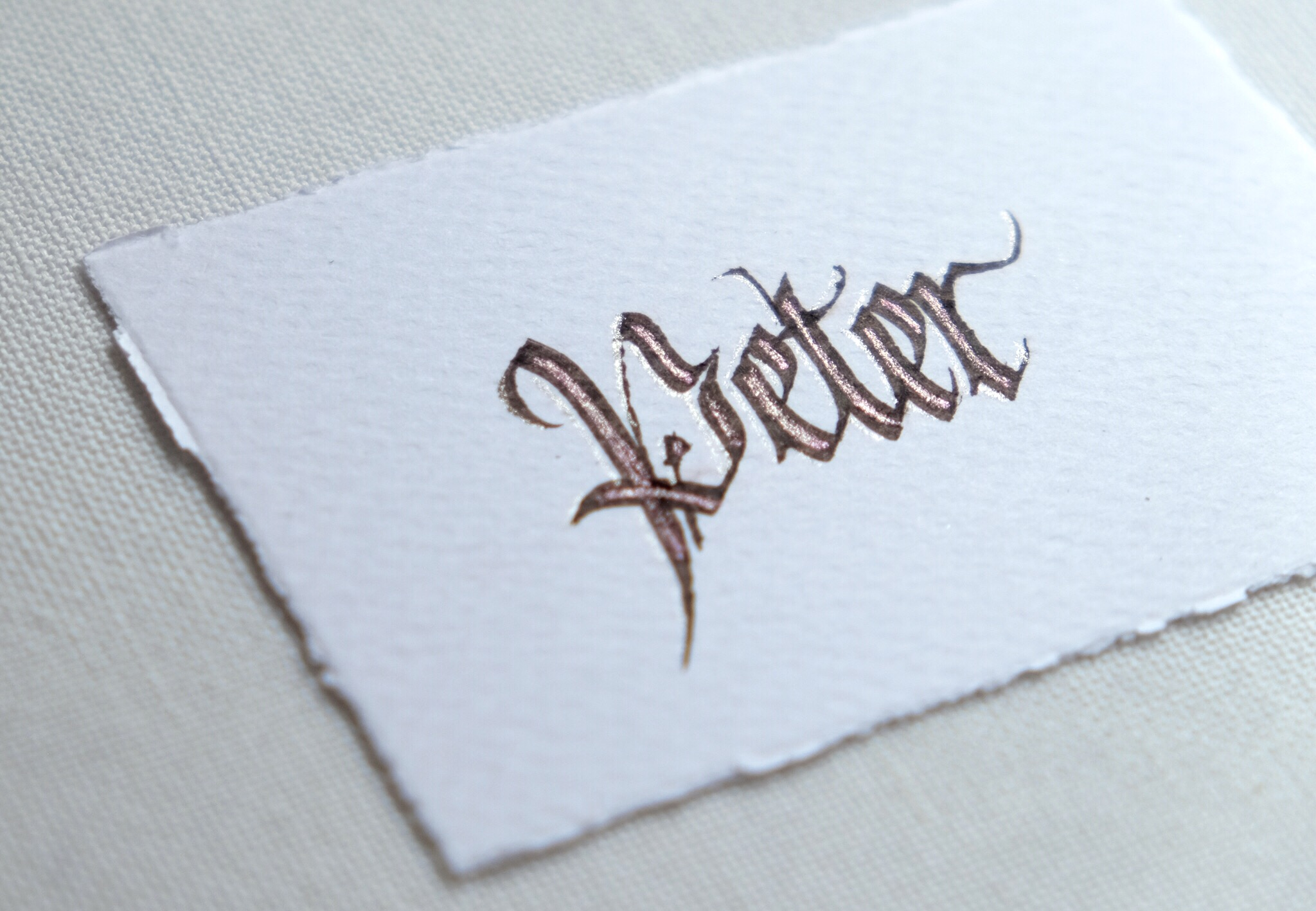 Blackletter fraktur calligraphy with decorative touches in glitter // calligraphy by Chavelli www.chavelli.com