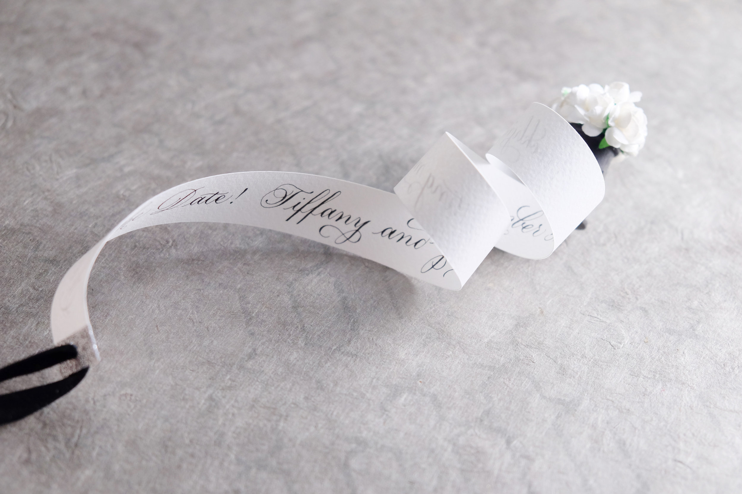 Hand-made scrolls with paper flowers and calligraphy for one-of-a-kind Save the Dates! // designed and hand-crafted by Studio Chavelli www.chavelli.com