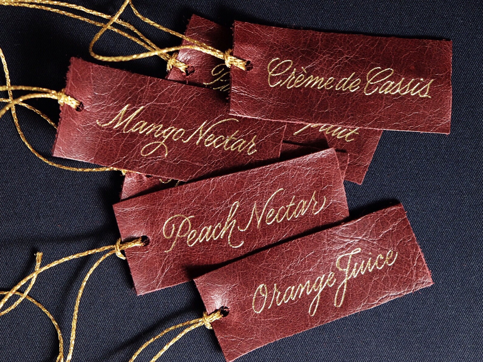 Leather name tags with gold foil calligraphy // www.chavelli.com