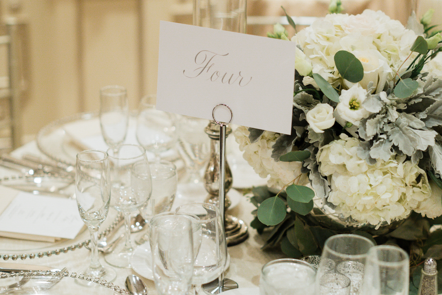 Table numbers in silver calligraphy script | www.chavelli.com