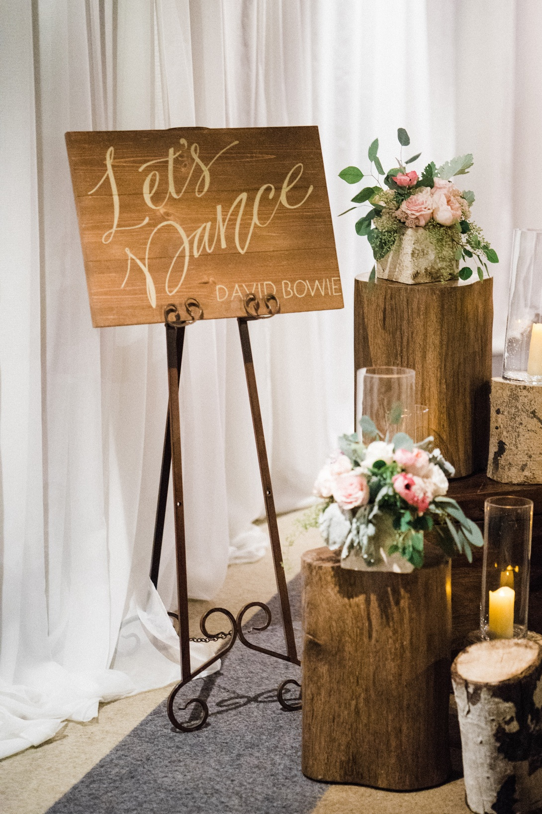 Hand-lettered wedding dance floor signage on stained wood | www.chavelli.com
