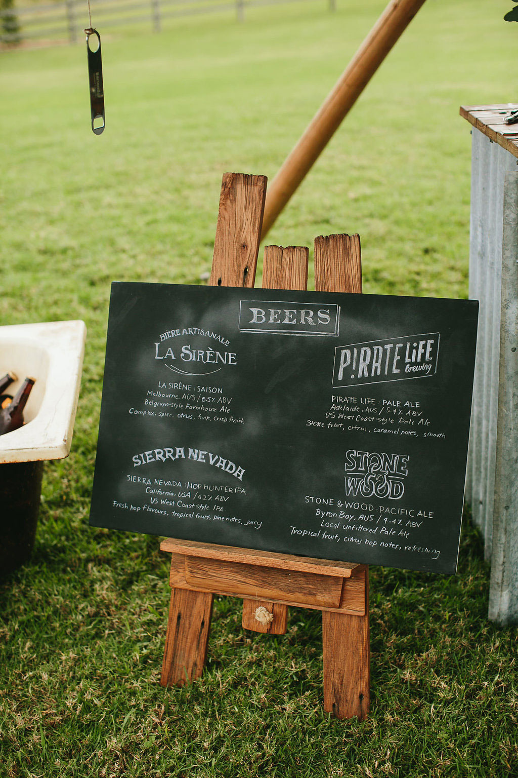 Beer menu chalkboard sign for an outdoor Byron Bay wedding in Australia | www.chavelli.com