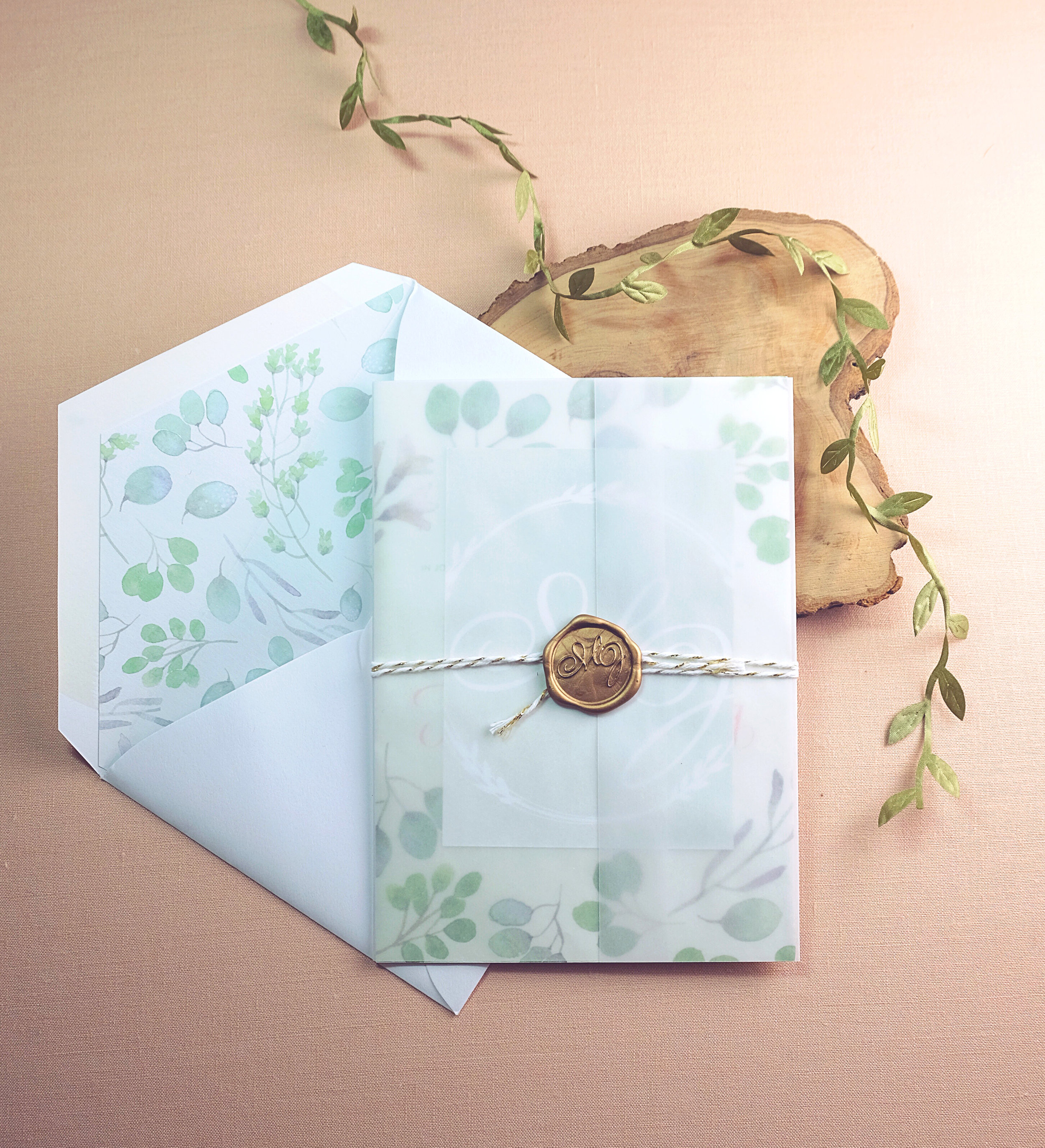Wedding invitation with a wax seal, watercolor florals and letterpress printed calligraphy | www.chavelli.com