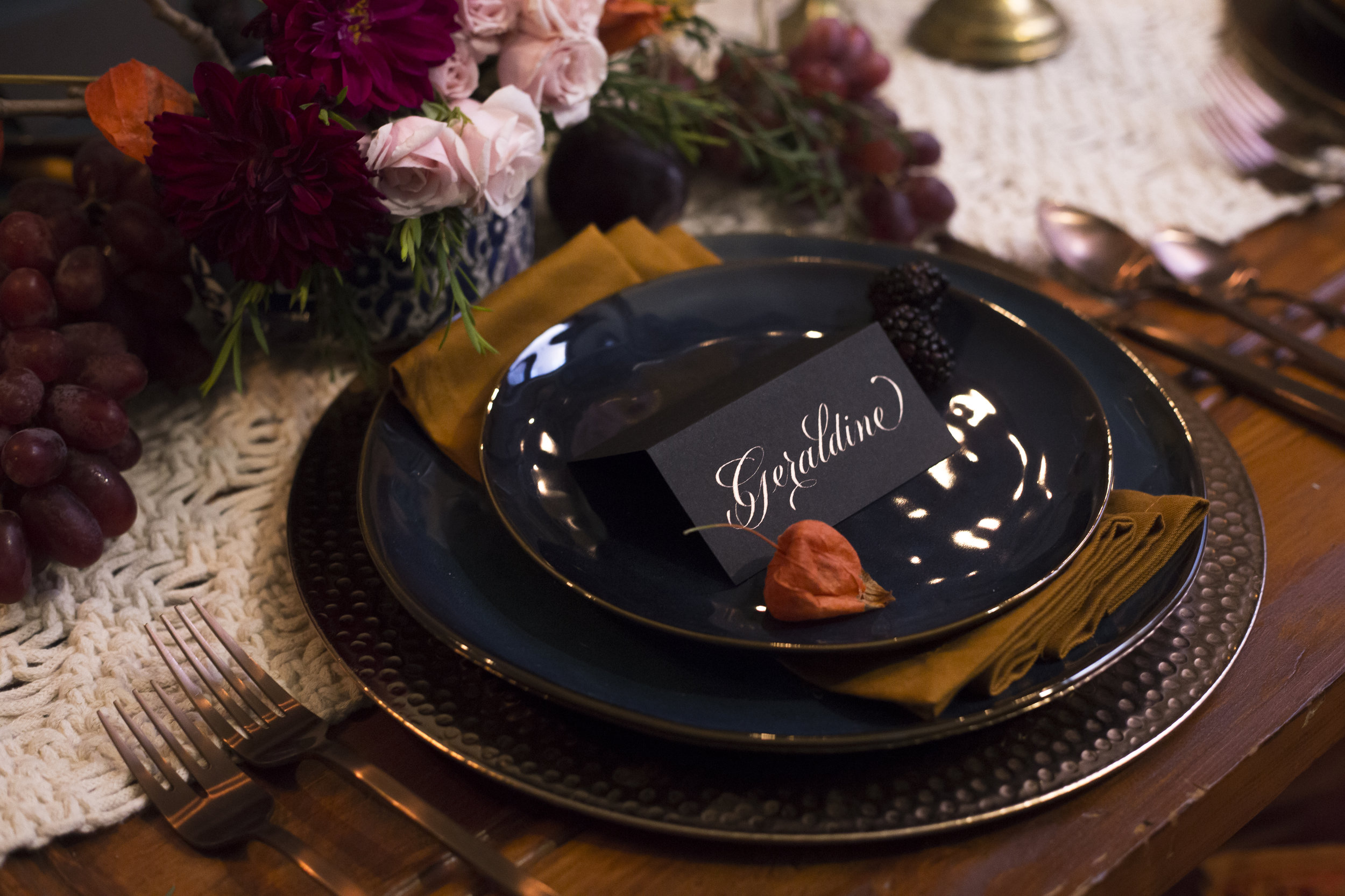 Copper script calligraphy on black place cards   by Chavelli www.chavelli.com