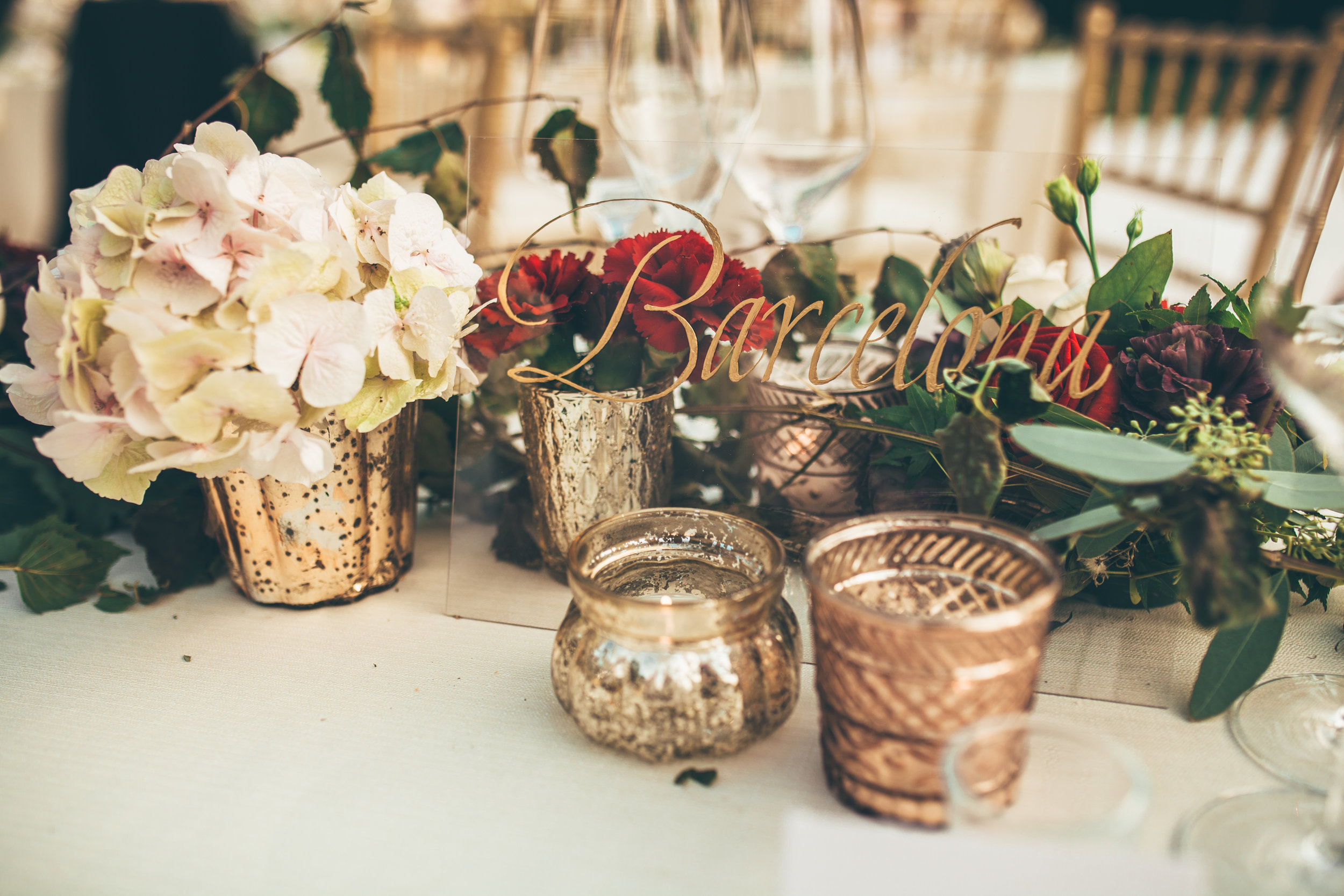 Wedding table names written in gold italic calligraphy   by www.chavelli.com