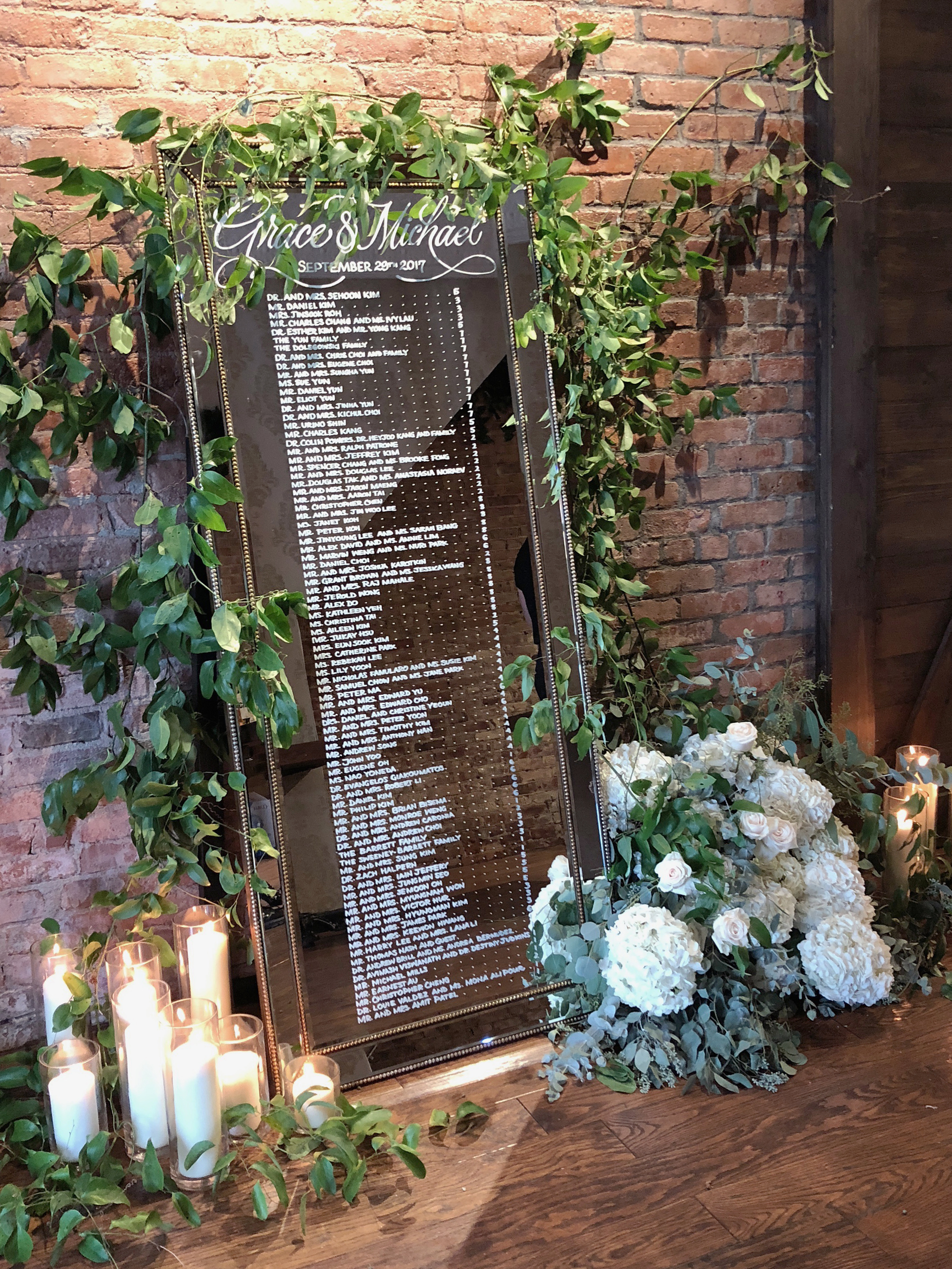 Mirror wedding seating chart with calligraphy   by www.chavelli.com