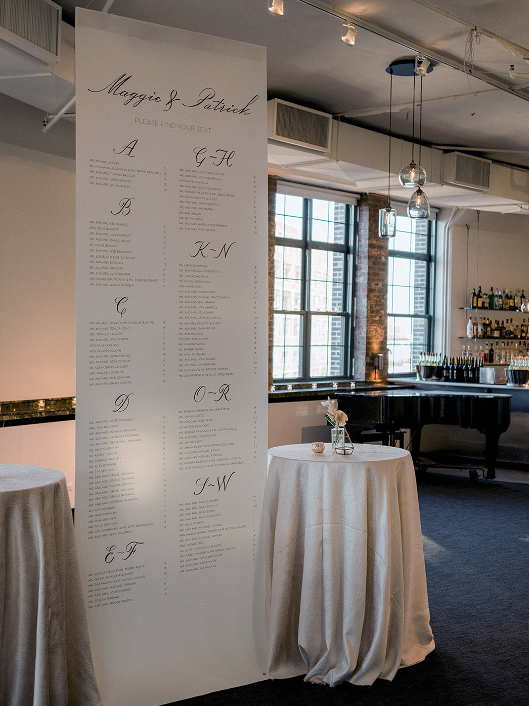 Handwritten hanging wedding seating chart, at Tribeca Rooftop | calligraphy and design by Chavelli www.chavelli.com