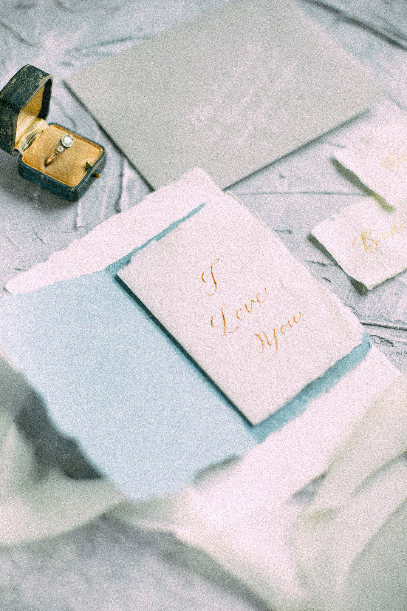 Custom crafted wedding vow booklets written in gold hand-calligraphy on hand-made paper | www.chavelli.com