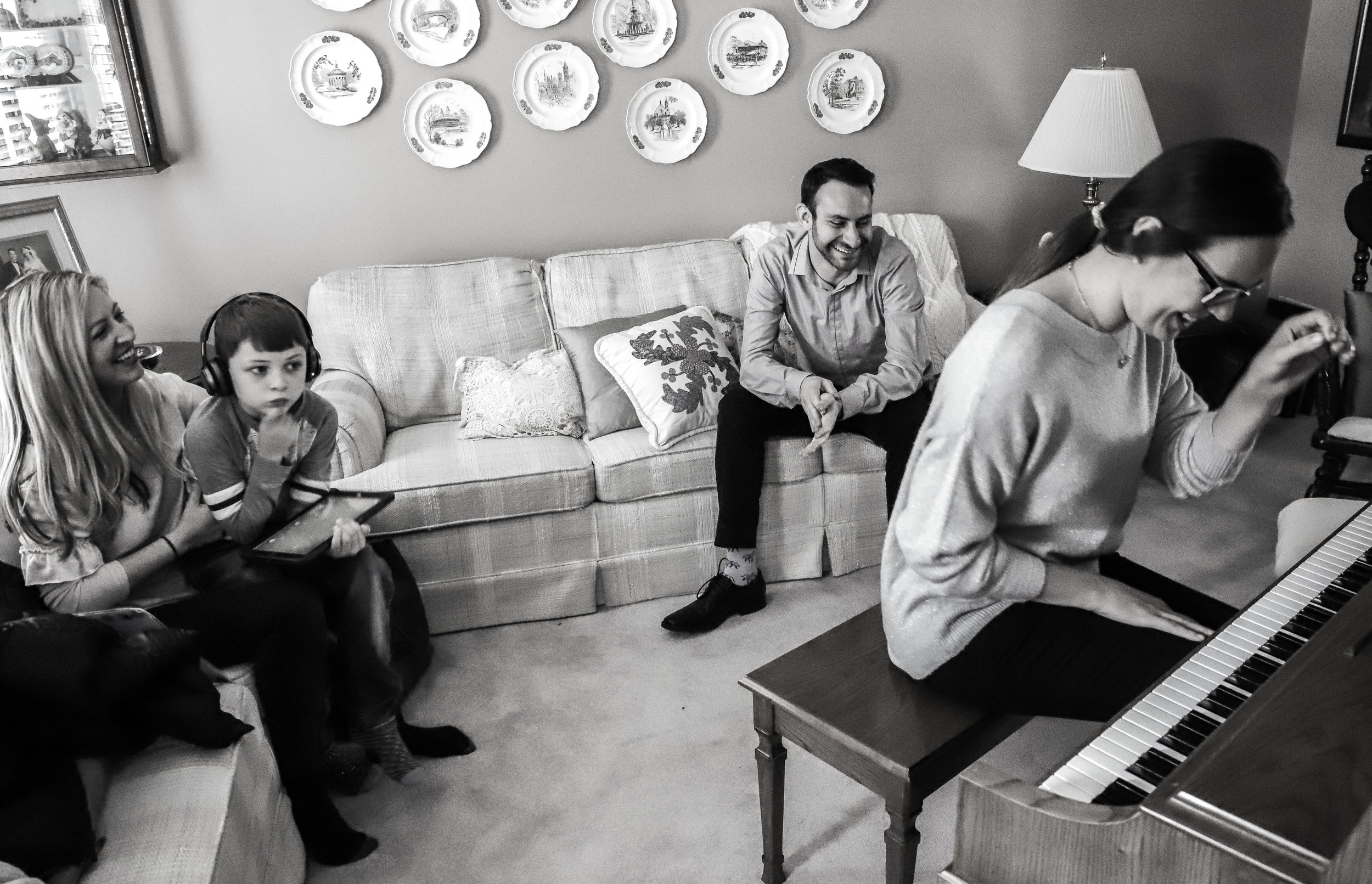 Luke Burke and his mom Cindy Burke listen to Simon Barrad and Kseniia Barrad practice their music. Luke was one of the writers for the Lynx Project's 2018 Cincinnati concert. The Lynx Project is a nonprofit organization that brings musicians and composers together to perform poems written by young writers with non-verbal autism.