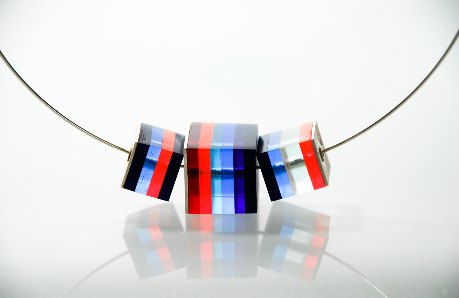 One large &two small Cube Necklace.  Silver & Plexiglas pendant on silver choker. €180