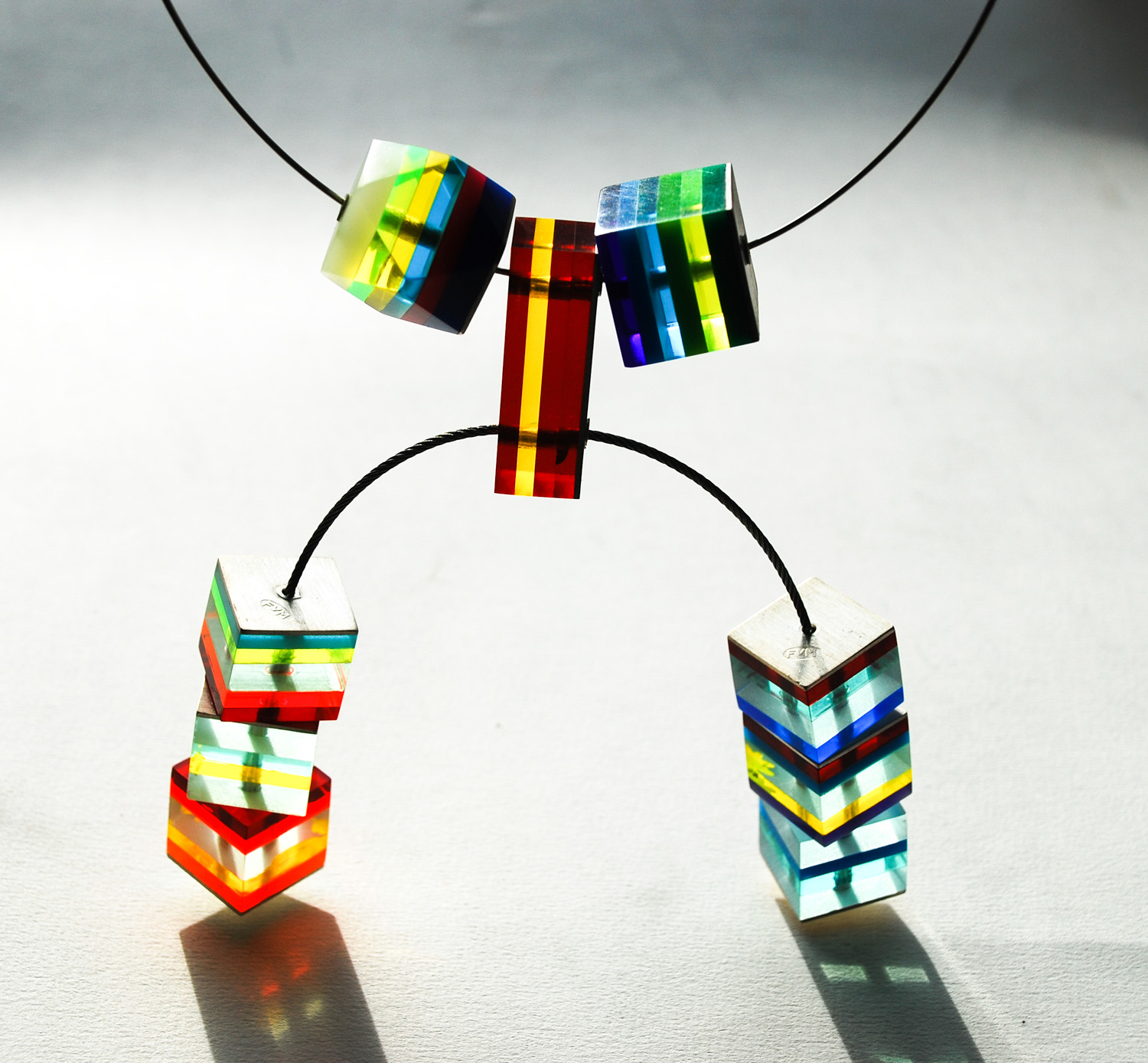 Statement Necklace with large cubes and hand carved Icosahedron form on silver choker + stainless steel wire. Price on application.