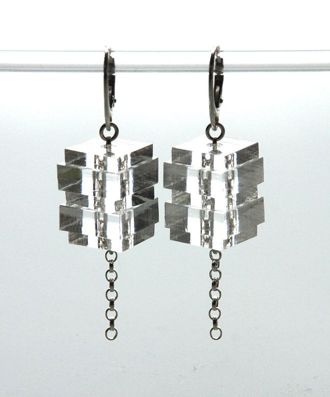 Medium drop earrings.    Plexiglas squares on silver belcher chain.   €50