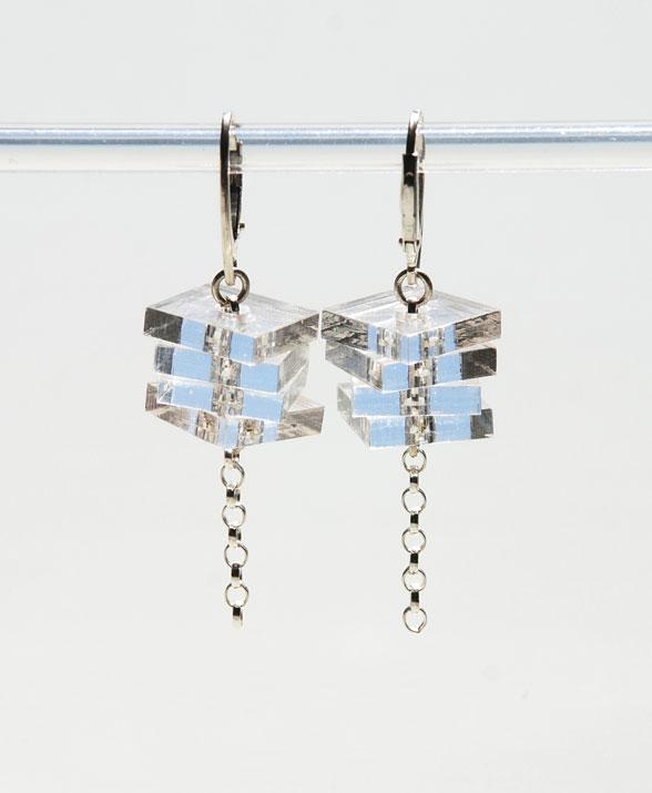 Small drop earrings.    Plexiglas squares on silver belcher chain.   €40.00