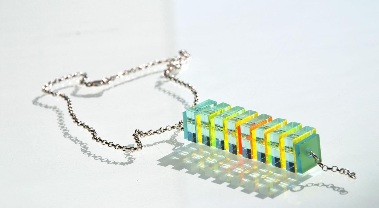 Long Pendant.    Silver Belcher chain & 13/15mm Plexiglas.   €75.00