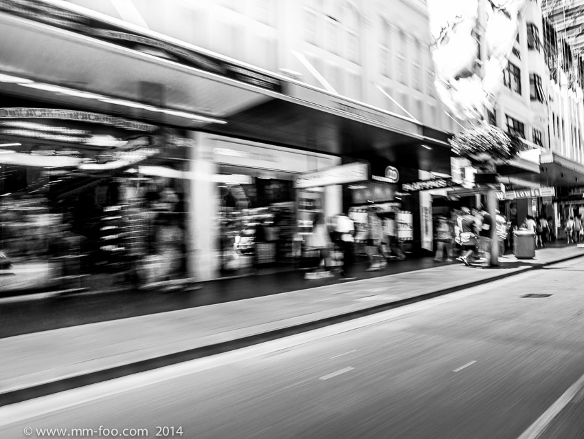 1/15 sec, 12mm, f/8.0, ISO100. M.Zuiko 12mm f/2.0. Rested on car window frame and taken on George St.